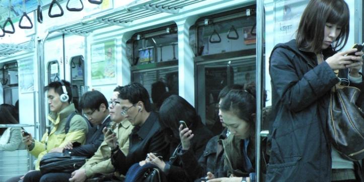 korean smartphone users on subway.jpg